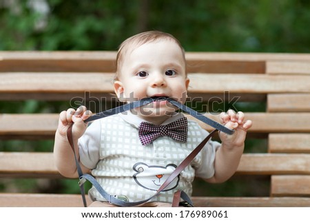 happy child on the bench - stock photo