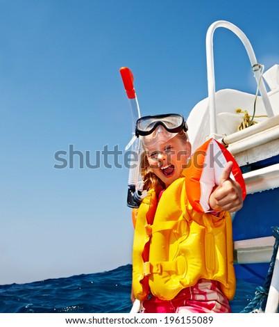 Happy  child on yacht thumb up. Snorkeling travel. - stock photo