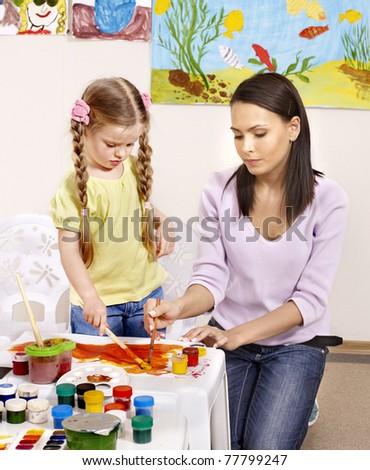 Happy child painting in preschool. - stock photo