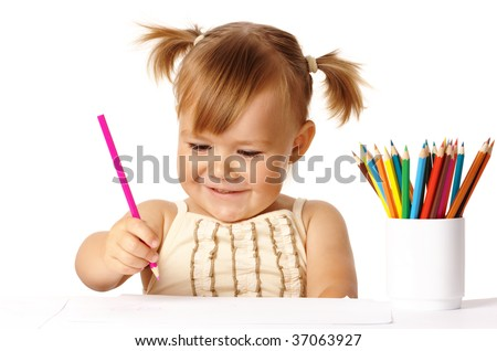 Happy child play with color pencils and smile, isolated over white - stock photo