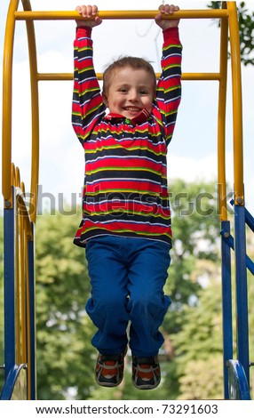 happy child playing at a playground. - stock photo