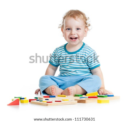 happy child playing educational toys isolated on white