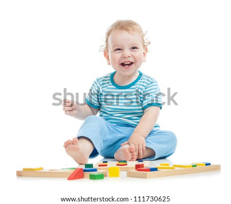 happy child playing educational toys on floor - stock photo