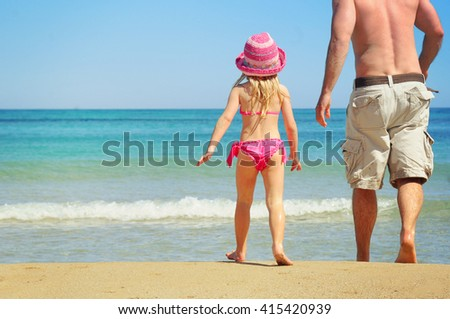 Happy child playing iwith her father. Summer vacation concept