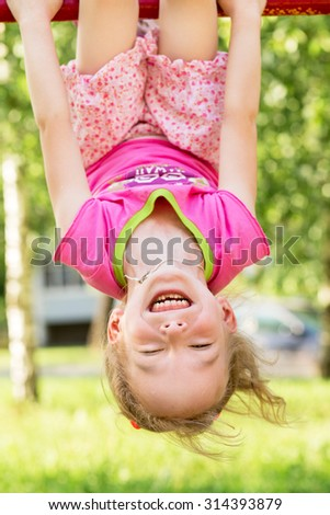 Happy child playing outdoors in summer park - stock photo