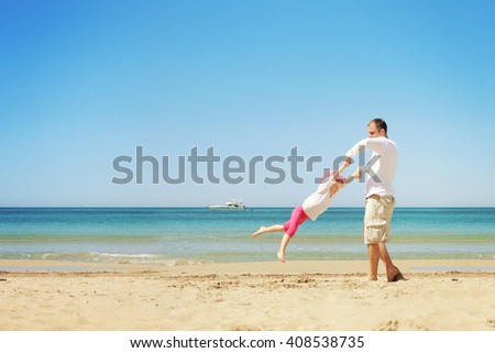 Happy child playing with her father. Summer vacation concept