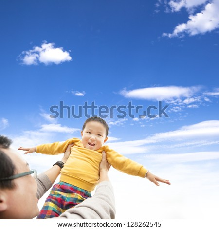 happy child playing with his father - stock photo