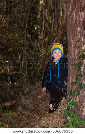 happy child plays in the forest