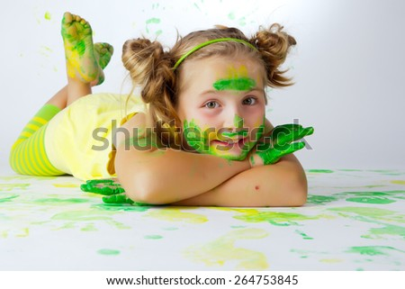 Happy child plays in the paint at home during the renovation. - stock photo