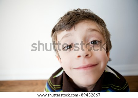 Happy child portrait in natural light with wide angle distorted face