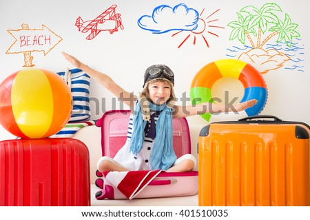 Happy child ready for a summer vacation. Kid having fun at home - stock photo