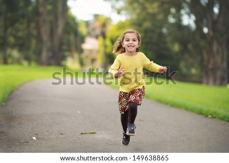 Happy Child Running in the Park - stock photo