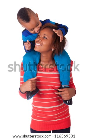 Happy child  smiled on the shoulders of her mother - stock photo