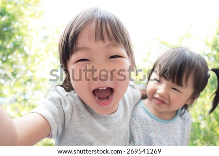 Happy child take a selfie in the park, asian - stock photo