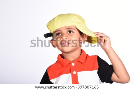 Happy child wearing yellow hat on isolated white  background - stock photo