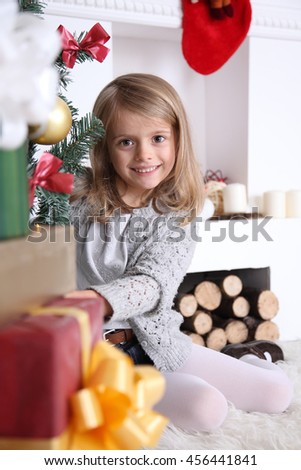 Happy child with Christmas gifts. New Year gifts to the children. - stock photo