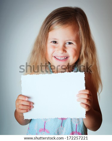 Happy child with paper blank - stock photo