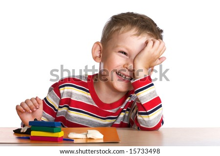 Happy child with plasticine - stock photo