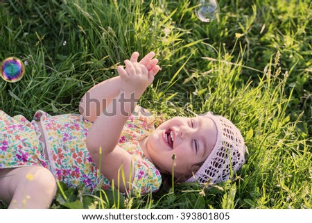 happy child with soap bubbles outdoor - stock photo