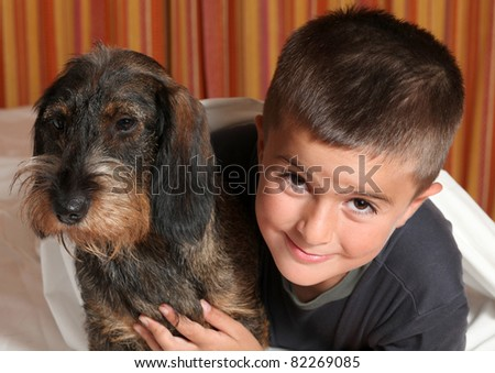 Happy child with the dog - stock photo