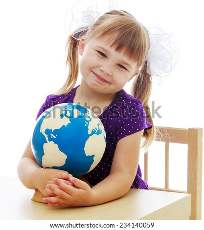 Happy childhood, adolescence, the development of the family concept. Little girl examines the globe isolated on white background. - stock photo