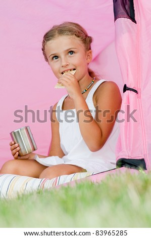 Happy childhood - Camping in tent - girl on camp tent - stock photo