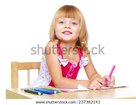 Happy childhood, joy of learning, creativity, child concept.little girl in a red dress draws.Isolated on white background. - stock photo