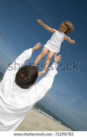 Happy childhood - little girl playing with father - stock photo