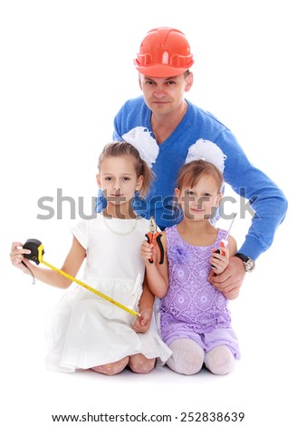 Happy childhood, the family concept.cheerful dad in the construction helmet with their cheerful daughters who are holding construction tools. Isolated on white. - stock photo