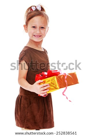 Happy childhood, the family concept.Closeup of a cute little girl with a gift in their hands. Isolated on white. - stock photo
