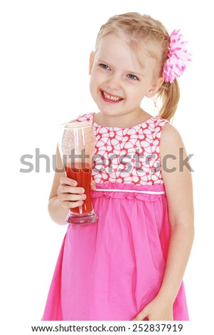 Happy childhood, the family concept.Laughing little girl with a glass of tomato juice in hand.Isolated on white. - stock photo