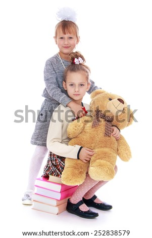 Happy childhood, the family concept.Portrait of pretty girls schoolgirls. Isolated on white. - stock photo