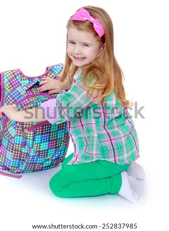 Happy childhood, the family concept.Smiling little girl with school bag.Isolated on white. - stock photo