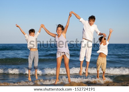 HAppy children are jumping on beach, outdoor