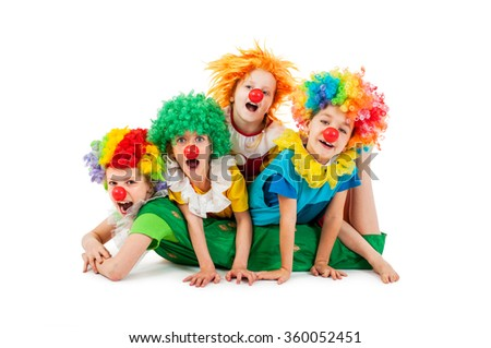 Happy children at the party in clowns costume - stock photo