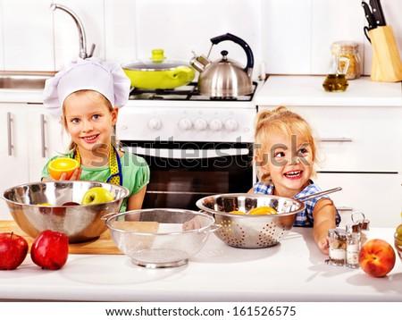 Happy children  breakfast at kitchen - stock photo