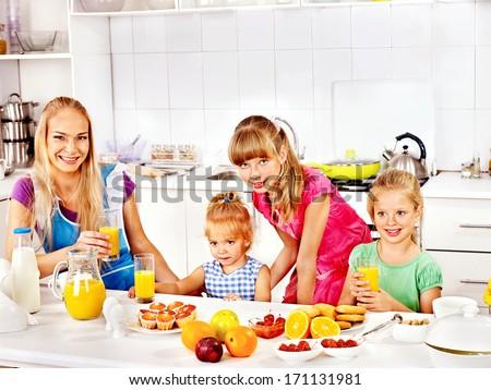 Happy children breakfast at kitchen. - stock photo