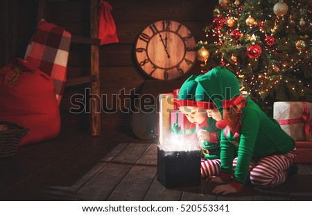 happy children brother and sister  elf, helper of Santa with a Christmas  magic  gifts