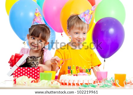 happy children celebrating birthday party with opening gift box - stock photo