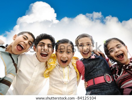 Happy children group laughing in camera, outdoor - stock photo