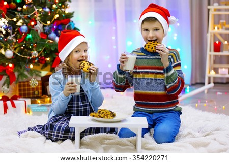 Happy children have a meal in the decorated Christmas room