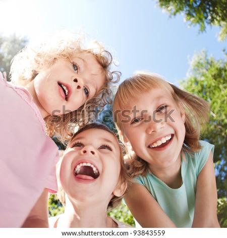 Happy children having fun in spring - stock photo