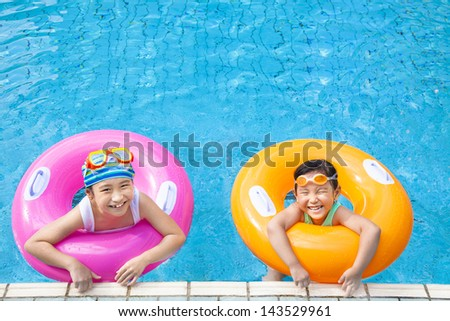 happy children having fun  in the swimming pool - stock photo
