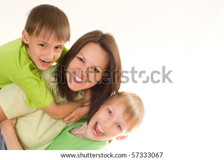 happy children hugging their mom on the wite - stock photo