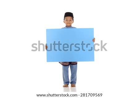 Happy children in a festive celebration holding a blue board isolated over white background