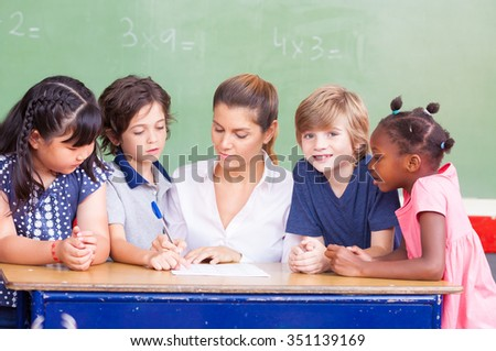 Happy children in a multi ethnic elementary classroom. - stock photo