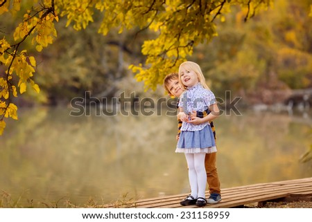 Happy children in autumn park - stock photo