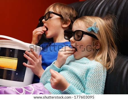 Happy children in 3d glasses watching movie at home  - stock photo