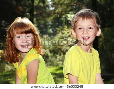 Happy children in forest - stock photo
