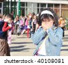 Happy children in front of the school, outdoor, summer to fall - stock photo